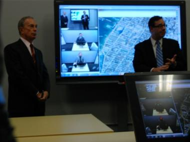 Mayor Michael Bloomberg and Buildings Commissioner Robert LiMandri show how different agencies can communicate at once using the hub.