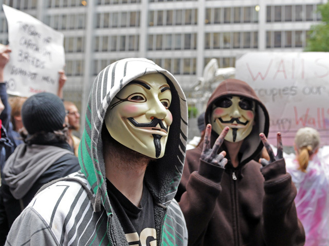 Some protesters wore Guy Fawkes masks.