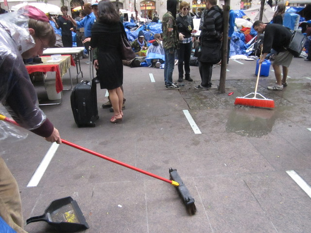 Two protesters cleaned Zuccotti Park Oct. 12, 2011, but neighbors still complain that the plaza is a health hazard.