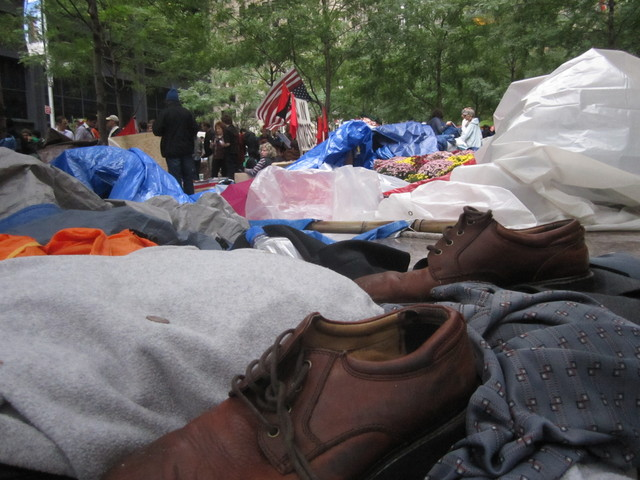 Mounds of clothes and shoes are a common sight in Zuccotti Park.
