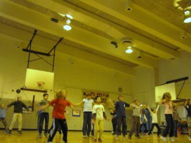Students in a gym class participated in a national effort to break a jumping jacks world record.