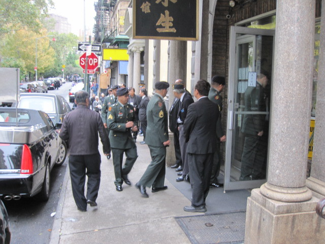 Military personnel enter the Wah Wing Sung funeral home on Mulberry Street for services on Thurs., Oct. 13, 2011.