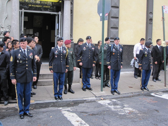 Military personnel line the street prior to the funeral procession on Thurs., Oct. 13, 2011.