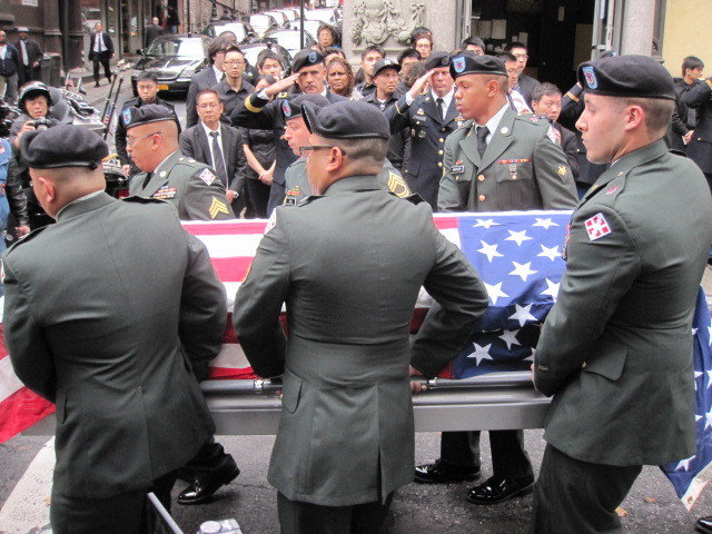 Pallbearers load Pvt. Danny Chen's casket during funeral services in Chinatown on Thurs., Oct. 13, 2011.