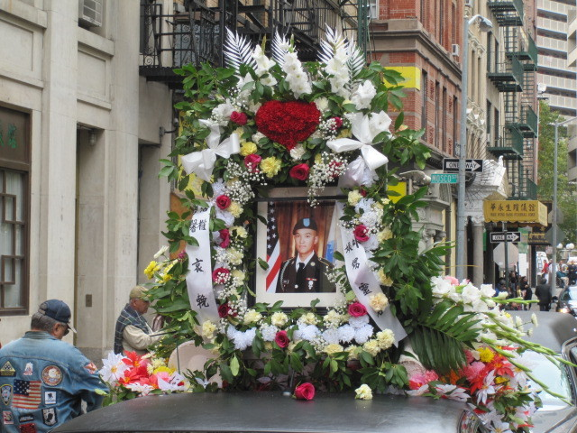 A flower arrangement containing a picture of Pvt. Danny Chen.