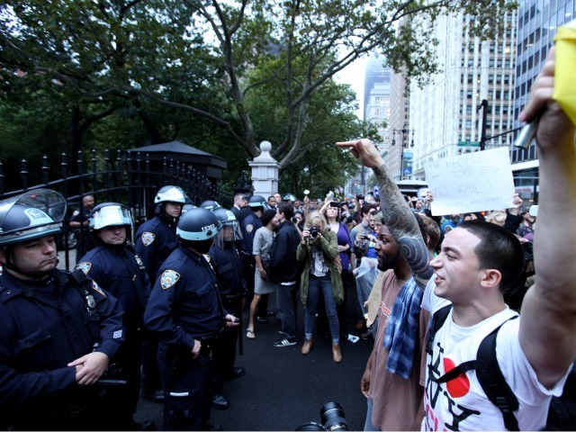 Protesters celebrated with impromptu marches, including one to City Hall where demonstrators faced off with riot police.