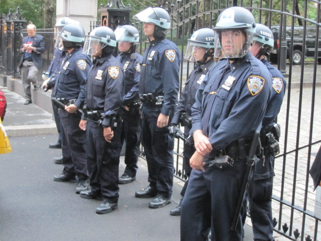 Police stand guard outside City Hall on Broadway during an Occupy Wall Street march on Fri., Oct. 14, 2011.