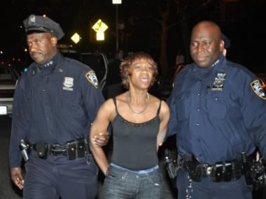 The mother of Sean Hines, who was stabbed to death in his apartment on West 92nd Street on Oct. 14, 2011, is led from the building in cuffs.