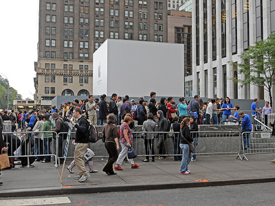 Apple devotees line up outside the Fifth Avenue Apple Store on Oct. 14, 2011 for the release of the iPhone 4S.