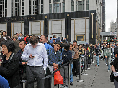 Long lines form at the Apple Store on Fifth Avenue on Oct. 14, 2011 for customers waiting to buy the new iPhone 4S.