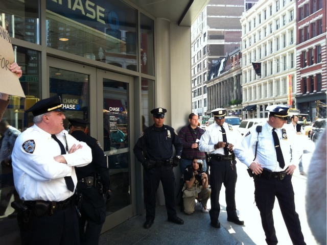 Cops stand guard at a Chase bank branch on Astor Place and Lafayette Street where Occupy Wall Street protesters gathered on Oct. 15, 2011.