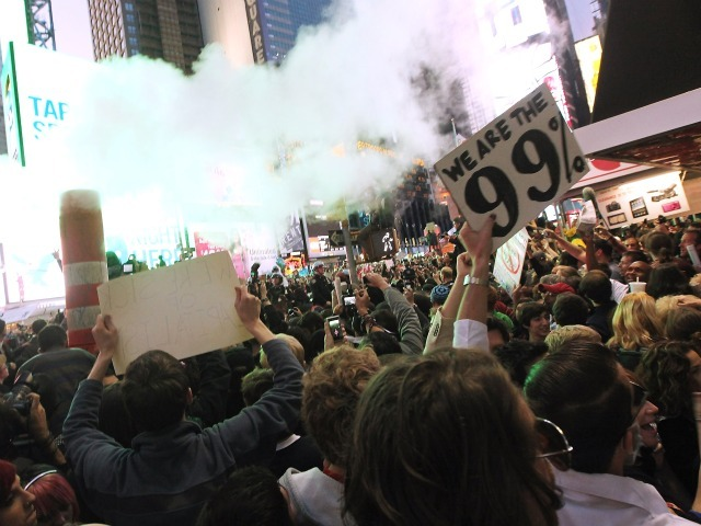 Demonstrators associated with the 'Occupy Wall Street' movement protest in Times Square on October 15, 2011 in New York City. Thousands of people are taking to the streets in cities across the world today in demonstrations inspired by the 'Occupy Wall Street' protests against the global financial system that began here in New York.