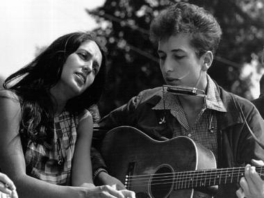 Folk singers Joan Baez and Bob Dylan, who are both discussed in a new folk documentary, perform during a civil rights rally on Aug. 28, 1963 in Washington D.C.