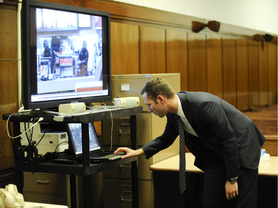 Assistant District Attorney Jamie Mendoza plays the video of the McDonald's altercation for a Manhattan judge on Oct. 18, 2011.