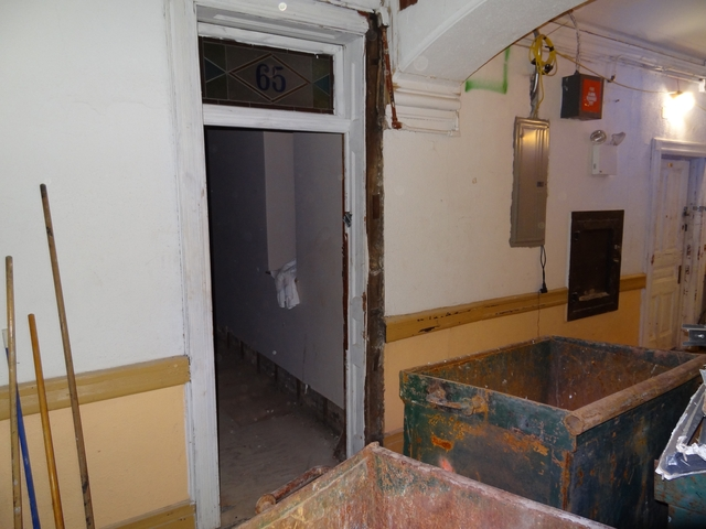 Many of the hotel's hallways are covered in small dumpsters.