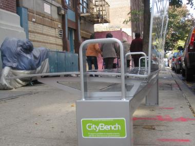 A group of seniors pass a CityBench outside a senior center on East 109th between First and Second avenues.
