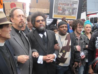 Cornel West marches on West 125th Street in Harlem to protest the NYPD's stop and frisk policies.