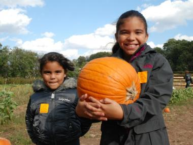 A proud Mariah Matos, 8, shows off her pumpkin, which she hoped to carve into a scary face.