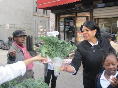 Fresh kale was given away outside Lenox Finest Food Market on West 116th Street to celebrate Food Day and the first Fresh Bodega site in Harlem.