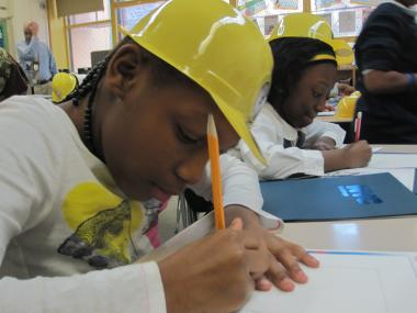 A student in a fourth-grade class at P.S. 175 draws her favorite building as part of the DOB's Junior Architects and Engineers program on Tues., Oct. 25, 2011.