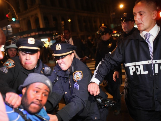 Police arrest an Occupy Wall Street protester during a demonstration to show support for their counterparts in Oakland, California on October 26, 2011 in New York City. Police fired tear gas into a crowd of hundreds of protesters associated with the Occupy Oakland movement last night following their eviction from a local park.