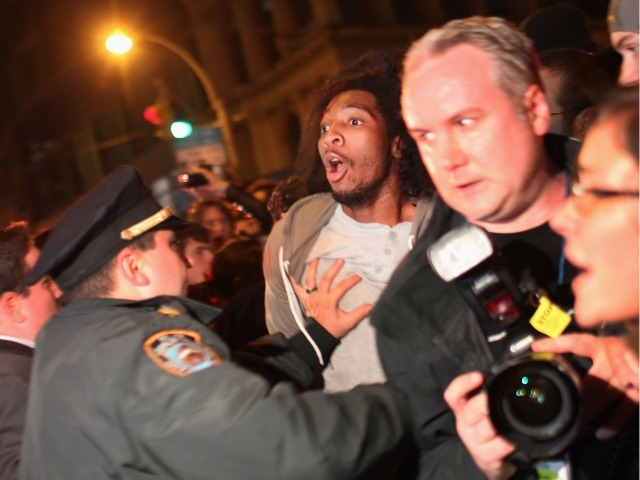 Police arrest an Occupy Wall Street protester (center) during a demonstration to show support for their counterparts in Oakland, California on October 26, 2011 in New York City. Police fired tear gas into a crowd of hundreds of protesters associated with the Occupy Oakland movement last night following their eviction from a local park.