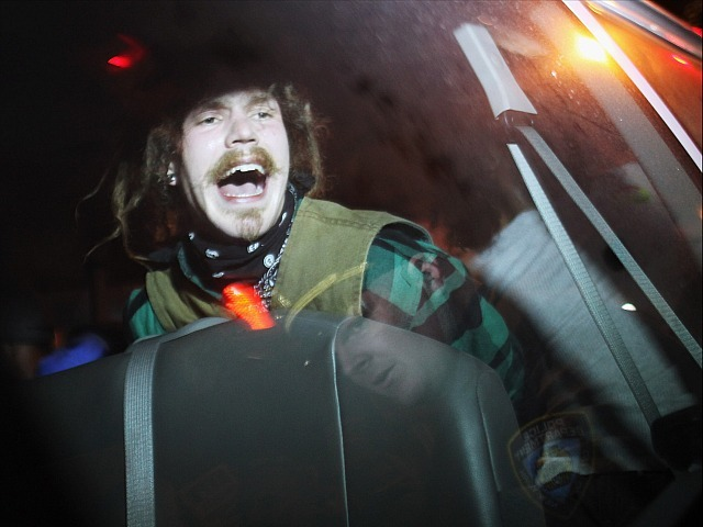 An Occupy Wall Street protester sits in a police van after being arrested during a demonstration to show support for their counterparts in Oakland, California on October 26, 2011 in New York City. Police fired tear gas into a crowd of hundreds of protesters associated with the Occupy Oakland movement last night following their eviction from a local park.