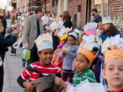 Children line up to take part in the Muscota New School Mad Hatter's Parade along Broadway on Tuesday, Oct. 25, 2011.