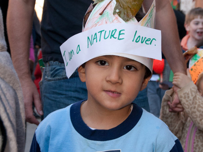 A nature loving student at the Muscota New School Mad Hatter's Parade.
