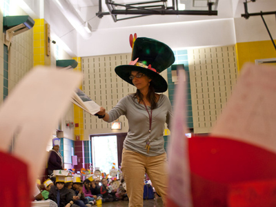 Muscota New School Principal Camille Wallen dresses as the Mad Hatter for the school's Mad Hatter Parade on Oct. 25, 2011.