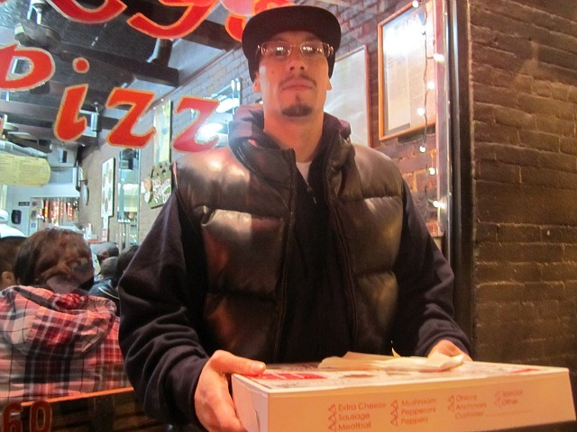 Ray's Pizza fan John Mooney said Oct. 28, 2011 that he would try to eat as much Ray's Pizza as he could before the shop closed two days later.
