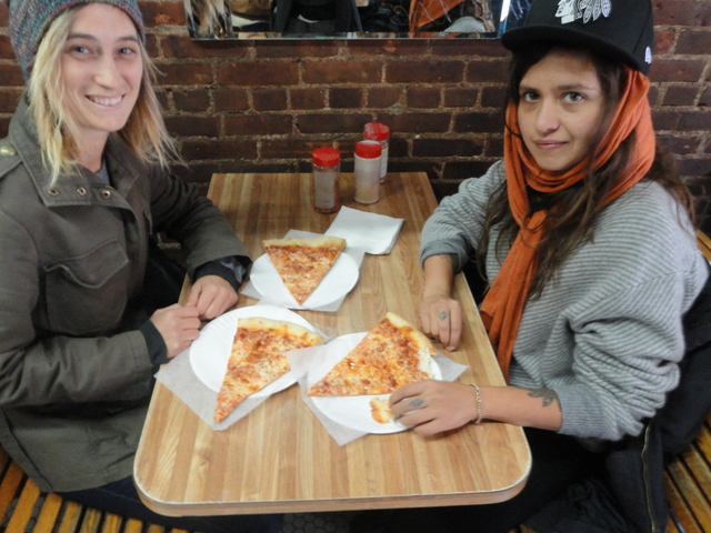 Rachel Pfennigwerth, 24, of the Upper West Side, and Randy Warshaw, 27, of the Lower East Side, enjoy a last slice at Ray's Pizza on Sunday, Oct. 30, 2011, the eatery's last day.