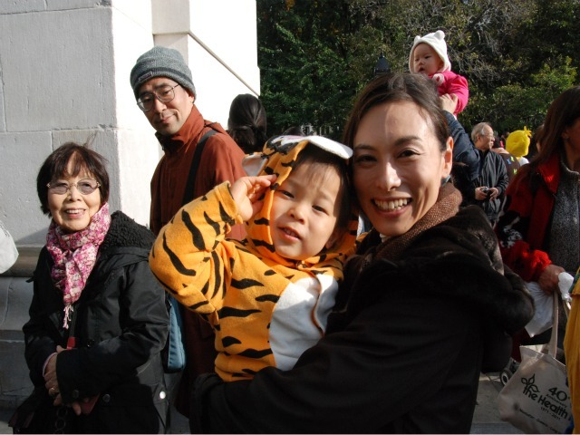 <p>Aya Wada, holds her 2-year-old son, Nozomi, who was dressed as Tigger for the children&#39;s Halloween parade.</p>