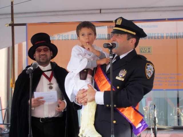 <p>6th Precinct Deputy Inspector Brandon del Pozo with his 4-year-old son, Zane, said the police department would &quot;do its best to deliver a safe and happy Halloween.&quot;</p>