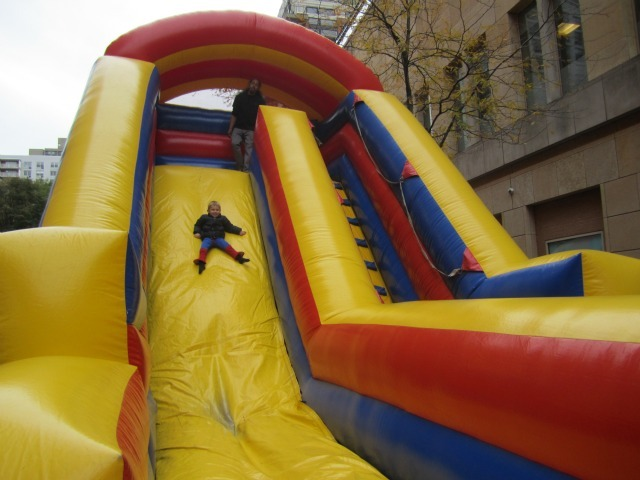 <p>Theo Valente, 3, had fun on the bouncy slide at the Village&#39;s Children&#39;s Halloween Parade.</p>