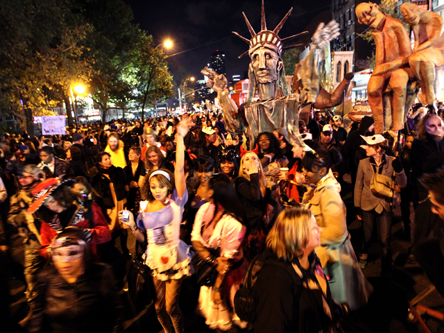 <p>Thousands of revelers swarm Sixth Avenue to enjoy this years Halloween Parade.</p>