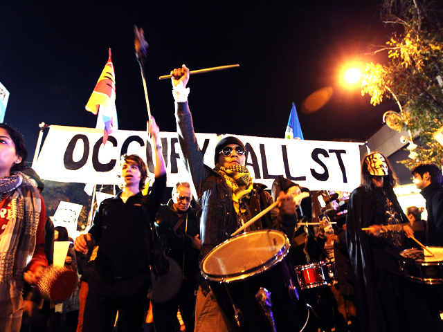 <p>Occupy Wall Street protesters join the annual Halloween parade.</p>