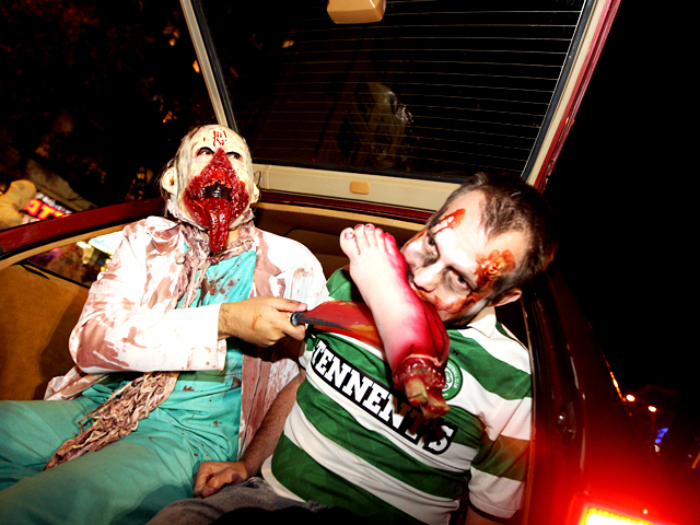 <p>Halloween revelers takes a bite out of this year&#39;s parade.</p>
