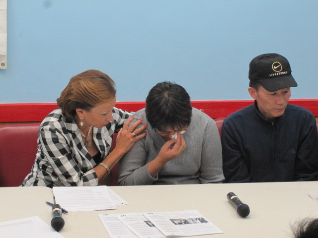 Rep. Nydia Velazquez consoles Su Zhen Chen, the mother of Pvt. Danny Chen, as his father Yan Tao Chen looks on during a press conference on Tues., Nov. 1, 2011.