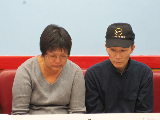 Su Zhen Chen and Yan Tao Chen, the parents of Pvt. Danny Chen, at a press conference on Tues., Nov. 1, 2011.
