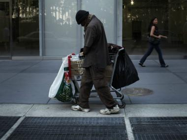 A homeless man walks down the street on June 20, 2011, in New York City.