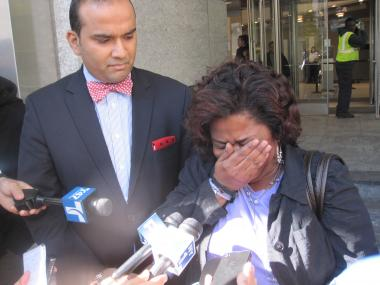 Rosemary Rosario with her son's attorney outside of court.