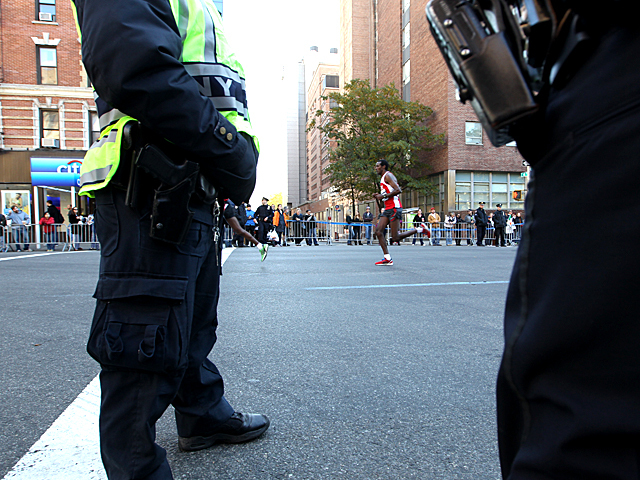 <p>A runner takes part in the NYC Marathon.</p>