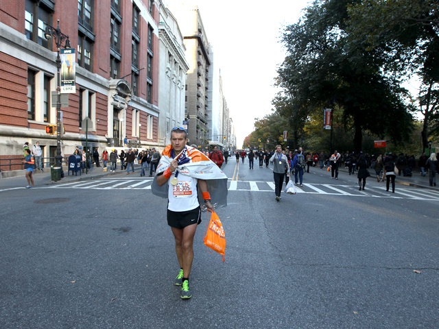 <p>A runner completes the NYC Marathon of 2011.</p>