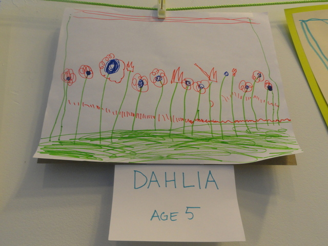Dahlia, 5, draws flowers in her fantasy park, imagining a greener future for a now vacant lot at West 20th Street in Chelsea