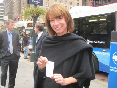 Transportation Commissioner Janette Sadik-Khan shows off her receipt, which is now needed to board buses on the stretch.
