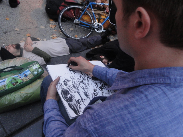 Protester sketching the scene at Foley Square, where the outsted Occupy Wall Street protesters went following the early morning raid on Tuesday 15th November, 2011.
