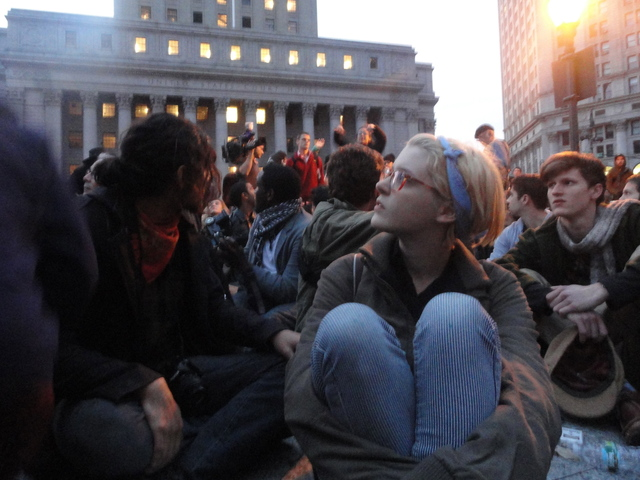 Protesters listening to announcements at Foley Square, where the outsted Occupy Wall Street protesters went following the early morning raid on Tuesday 15th November, 2011.