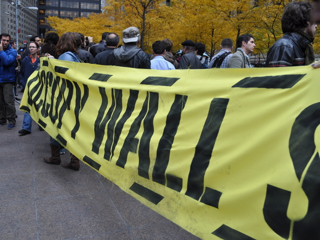 A group of protesters unwound a 12-foot long yellow banner that read