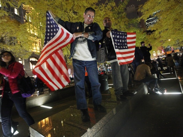 Occupy Wall Street Protesters celebrate after re-entering Zuccotti Park on November 15, 2011 in New York City. Police had removed the protesters from the park early in the morning.